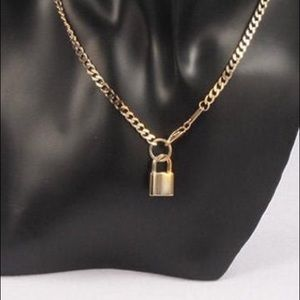 Gold chain necklace with lock pendant